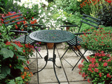 Metal Table and Chairs on Patio Backed by Pots with Lilium Longifolium Fotografie-Druck von Lynne Brotchie