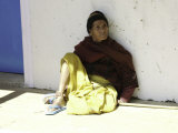 Old Woman Sitting Against a Wall, Nepal Photographic Print by David D'angelo
