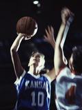 Two Young Women Playing Basketball Lámina fotográfica
