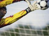 Goalie Attempting to Stop a Soccer Ball Lámina fotográfica