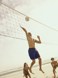 Low Angle View of Three People Playing Volleyball on The Beach Fotografisk trykk