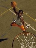 High Angle View of a Basketball Player Slam Dunking a Ball Lámina fotográfica