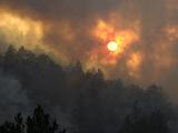 Sunset Breaks Through Smoke of the Hayman Wildfire Photographic Print
