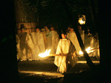 A Shinto Priest Walks, Holding a Wooden Torch, During the Tsukinami-Sai Ritual Photographic Print
