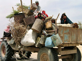 An Iraqi Family and Their Sheep Ride on Their Tractor to Fetch Water Outside the Town of Najaf Stampa fotografica