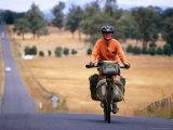 Cyclist on Road from Ormaston to Deloraine, Deloraine, Australia Lámina fotográfica por Trevor Creighton