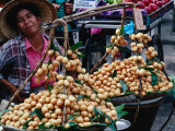 Woman with Food for Sale at Market Bangkok, Thailand Photographic Print by John Hay