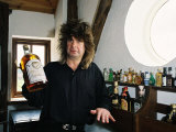 Black Sabbath Singer Ozzy Osbourne Holding a Large Bottle of Whiskey at His Home in 1988 Photographic Print