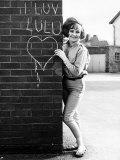 Lulu Standing Beside Wall, 1964 Photographic Print