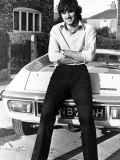 Footballer George Best Outside His Manchester Home Leaning Against His New Car Photographic Print