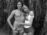 Motorcycle Champion Barry Sheene at Home with Girlfriend Stephanie Mclean in Garden by Willow Tree Photographic Print