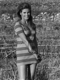 Actress Raquel Welch on Location For Film Shoot Wearing Striped Mini Dress and Holding Pitchfork Fotografie-Druck