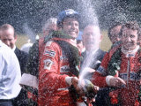 Carlos Reutemann of Ferrari Winner with Champagne After Motor Racing Fotografie-Druck