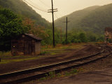 Railroad Through the Old Town of Thurmond, West Virginia Photographic Print by Raymond Gehman