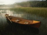 An Adirondack Guide Canoe Floating on Connery Pond at Sunrise Lámina fotográfica por Melford, Michael
