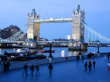People Walking Along Queens Walk on the Thames at Dusk with Tower Bridge in the Background Photographic Print by Orien Harvey