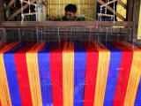 Man Weaving Cloth Photographic Print by Uros Ravbar