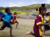 Local School Girls Competing in Race During an Inter-Island School Sports Carnival Photographic Print by Tim Barker