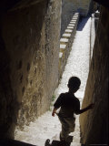 Young Boy in Tower of Castelo de Sao Jorge, Portgual Stampa fotografica di John & Lisa Merrill