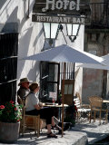 Tourists Drinking Outside a Hotel in Real de Catorce, Mexico Fotoprint av Alexander Nesbitt