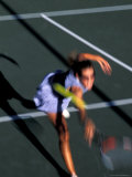 Woman Playing Tennis, Colorado, USA Photographic Print by Lee Kopfler