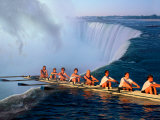 Rowers Hang Over the Edge at Niagra Falls, US-Canada Border Reproduction photographique Premium par Janis Miglavs