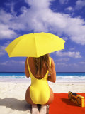 Woman in Yellow Swimsuit with Umbrella Reproduction photographique par Bill Bachmann