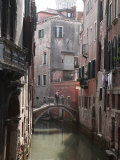 Young Adult Couple Hugging and Kissing on Bridge over Canal, Venice, Italy Photographic Print