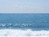 Crashing Ocean Waves and Vast Horizon under Blue Sky Photographic Print
