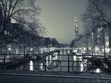 Prinsengracht met de Westerkerk in Amsterdam 's avonds Fotoprint van Jon Arnold