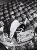 Pannetone, a Bottle of Champagne and a Glass Sitting on a Platter Photographic Print by A. Villani