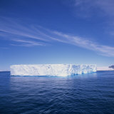 Tabular Iceberg in Blue Sea in Antarctica, Polar Regions Photographic Print by Geoff Renner
