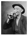 Happy Old Man Drinking Glass of Beer, with His Daintier Finger Extended. 1937 Photo