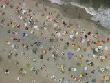 Aerial view of wall-to-wall seaside sunbathers Photographic Print by Emory Kristof