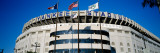 Flags in Front of a Stadium, Yankee Stadium, New York City, New York, USA Fotografisk trykk av Panoramic Images,