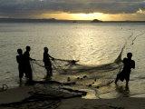 Fishermen Pulling in the Nets at Dawn, Ramena Beach, Diego Suarez, North Madagascar Photographic Print by Inaki Relanzon