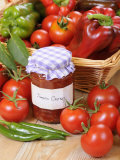 Country Kitchen Scene with Home Made Chutney and Ingredients - Tomatoes and Peppers, UK Valokuvavedos tekijänä Gary Smith