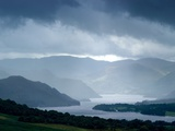 Foggy Landscape of River and Rolling Hills Posters av Tommy Martin