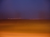 Blurred Scenery with Lights on Horizon Prints by Philippe Lejeaille