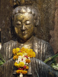 Statue with Offering of Marigold Flowers, Emerald Buddha Temple, Bangkok, Thailand, Southeast Asia Photographic Print by Alain Evrard