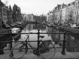 Black and White Imge of an Old Bicycle by the Singel Canal, Amsterdam, Netherlands, Europe Photographic Print by Amanda Hall