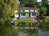 House with Pond in Garden, Coulon, Marais Poitevin, Poitou Charentes, France, Europe Fotografisk trykk av Miller John