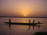 Children on Local Pirogue or Canoe on the Bani River at Sunset at Sofara, Mali, Africa Reproduction photographique par Pate Jenny