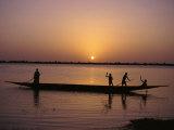 Children on Local Pirogue or Canoe on the Bani River at Sunset at Sofara, Mali, Africa Fotografisk trykk av Pate Jenny
