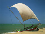 Fishermen in the Shade of a Sail on a Fishing Boat on the Beach at Negombo, Sri Lanka Photographic Print by Richardson Rolf