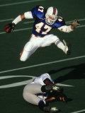 Football Running Back Flys over the Defense Reproduction photographique