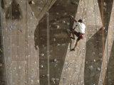 Man Wall Climbing Indoors with Equipment Lámina fotográfica
