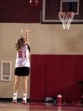 Teenage Girl Practicing Basketball Indoors Fotografisk trykk