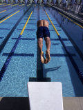 Swimmer Diving Off the Starting Blocks to Begin a Race Photographic Print by Steven Sutton