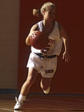 Female High School Basketball Player in Action During a Game Photographic Print
